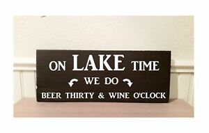 On lake time we do beer thirty and wine o'clock wood sign.  12