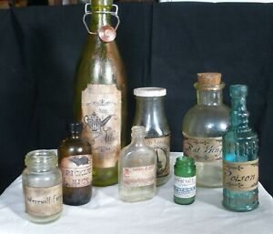 #4 Set of 8 Apothecary Bottles aged,with labels.Perfect for display or Halloween