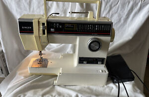 Singer Model 6235 sewing machine with pedal. Tested works $59.00