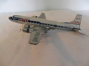 united airlines dc 7 tin friction airliner