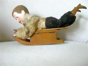 heubach boy doll on sled candy container