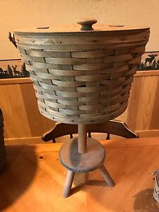 longaberger sewing basket on stand with working leather hinge with a spare top $170.00