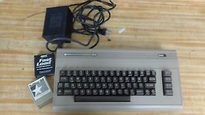 COMMODORE 64 VINTAGE COMPUTER with POWER SUPPLY and FAST LOAD CARTRIDGE