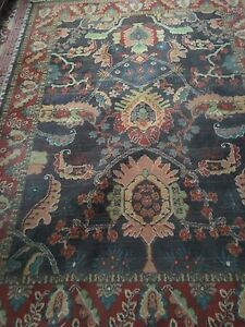 Bright Cheerful Wool Area Rug w. a Chocolate Brown Background.
