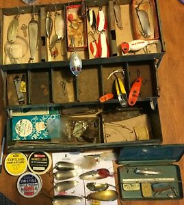 Vintage metal tackle box with lures