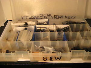 Lot of Various Smith & Wesson parts..triggers hammers yokes side plates etc.
