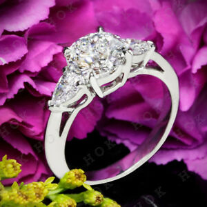 10k White Gold 2.00 Ct Round and Pear Cut Diamond Three Stone Engagement Ring