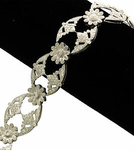 Magnificent 18K White Gold Openwork Floral Design Diamond Bracelet (7 CTW)