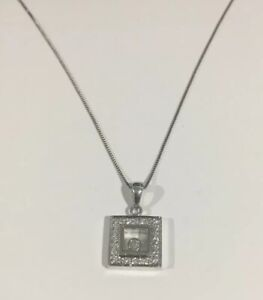 18k White Gold Floating Diamond Pendant With Silver Chain