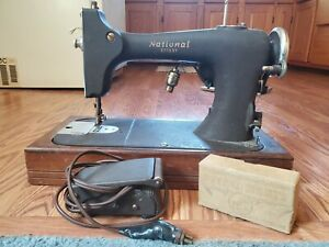 Vintage National Cast Iron Sewing Machine m. RBR w wooden base. needs work $120.00