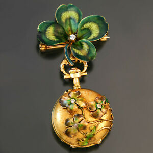 WOMENS GOLD ENAMEL PENDANT WATCH WITH FOUR LEAF CLOVER DESIGN  ANTIQUE CA1900S