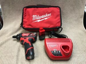 MILWAUKEE 12v LITHIUM-ION SCREWDRIVER KIT MODEL: 2401-20 CHARGER AND 2 BATTERIES