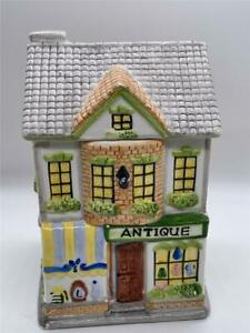 Store front shows quot;Antiquequot; on this large old Ceramic cookie Jar $39.95