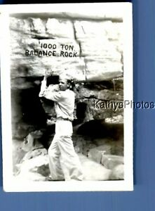 FOUND Bamp;W PHOTO K 1581 SIDE VIEW OF MAN UNDER LARGE ROCK $6.98