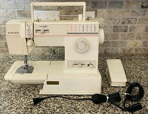 Singer Sewing Machine With Foot Pedal. Model 9005. $95.00