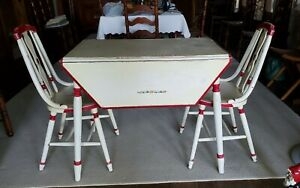 vintage drop leaf wooden table with two matching chairs $400.00