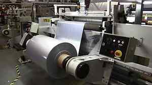 Atlas Slitter- Rewinder Arranged for Overhead Web Delivery and Radial Unloading