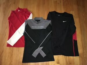 lot of 3 long sleeve dry fit compression shirts youth medium. nike under armour