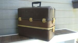 Vintage UMCO  Tackle box with possum belly. Color Brown.