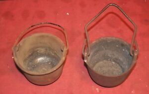 2 - cast iron lead melting pots 1 is Jones (fishing weights cast toys