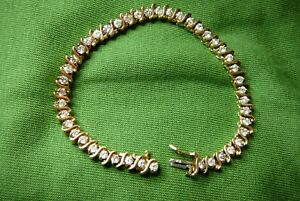 diamond tennis bracelet 3 ct 14 kt gold vintage S link preowned. Beautiful