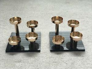Gold Candle Holders on Black Marble