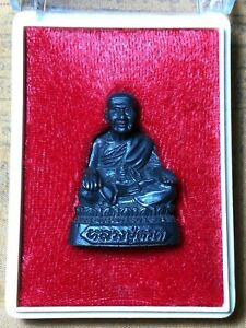 Luang Pu Thuat Bronze amulet - made by AIA (American International Assurance)