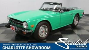 1976 TR-6 -- vintage classic chrome British compact sports car java green black wood grain