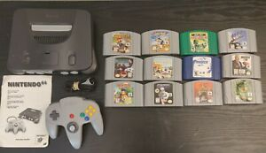 Nintendo 64 bundle w12 games! OEM manual Mario Kart 64 Diddy Kong Racing