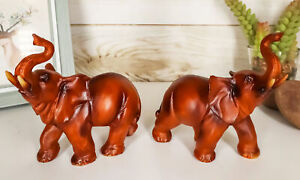 Ebros Faux Wood Feng Shui Elephant with Trunk Up Statue Set of 2 $19.99