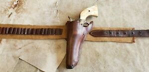Antique canvas gun belt and leather holster45 cal loops $200.00