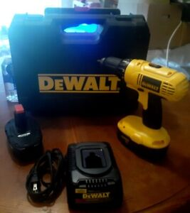 DEWALT Drill battery charger and 2 batteries $200.00