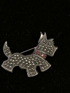 Vintage marked sterling dog brooch with garnet pieces rare to find $50.00