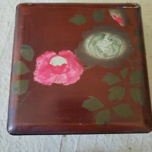 Black lacquered Japanese box with handpainted floral top $20.00