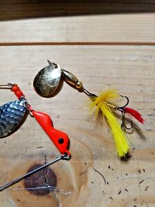 Old lures we have 1 joe#x27;s flies and a erie drie for walleye and trout fishing.