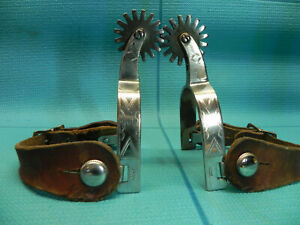 early pair of Kelly rodeo spurs