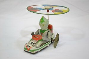 tin toy mirror man helicopter mainspring