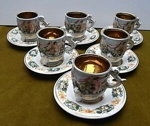6 gilded coffee cans and saucers with high relief