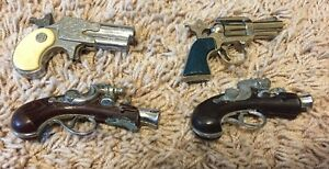 4 antique cap guns in varying condition zee