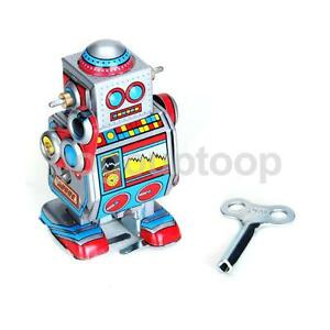 vintage wind up walking space robot
