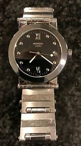 Movado Vizio stainless steel watch with stainless steel bracelet band.