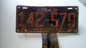 Antique Arkansas 1942 license plate with attached mount set