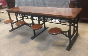 Kitchen Island Table with 8 Cast Iron Swing Out Stools