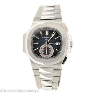 PATEK PHILIPPE NAUTILUS STAINLESS BLUE DIAL Box and papers