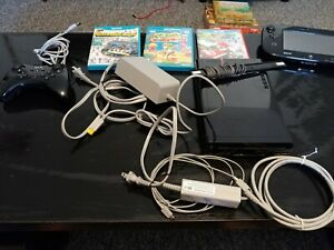 Nintendo Wii U 32GB Console Bundle with several games and controllers