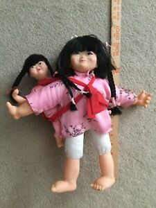 Vintage 2 Chinese dolls dad and mother with baby on back hong kong $25.00