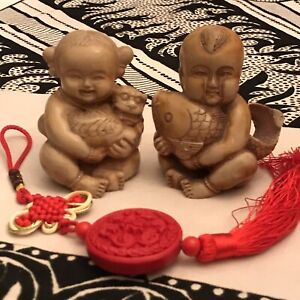 Pair of Vintage Faux Carved Baby Statue Chinese Sculptures Resin 3 Items Total $22.00
