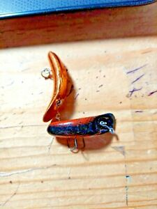 OLD LURES we have two flatfish for walleye fishing in different colors.f4 and f5