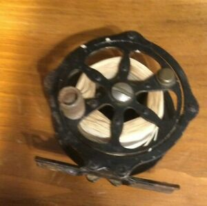 small unmarked skeliton style old fly fishing reel