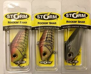 3 New Storm Rockin Shad 6 Fishing Lures; Fire Craw Brown Craw and Black Chrome